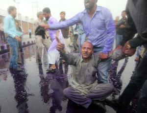 Er Rashid drenched in coloured water. Photo: Bilal Bahadur