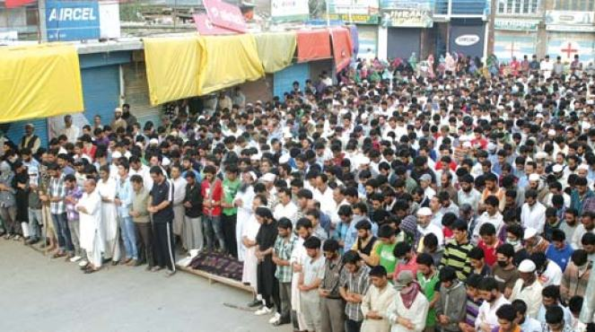 People offering funeral prayers of one of the slain youth in Shopian. Pic: Arif Wani