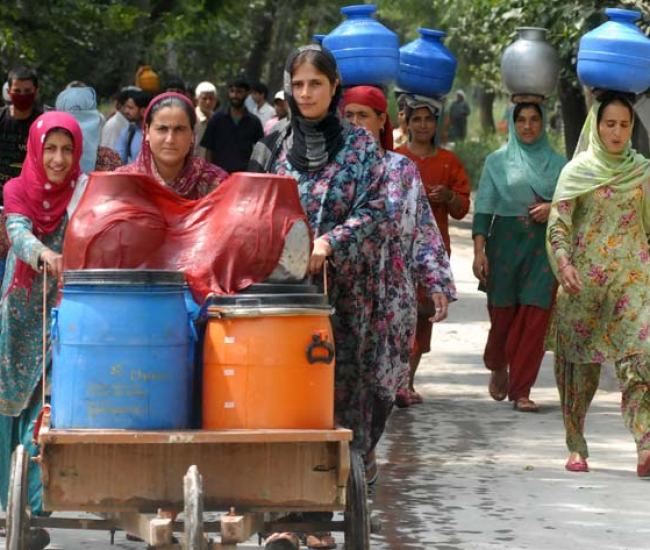 """Cult Cart: The water from Urin water scheme is usually supplied in the morning hours and that too for 15 to 30 minutes only, locals claim. """"Short timing is the worst problem,"""" Showkat, a local villager, says adding that the long queues often result in cat brawls among the women folk."""