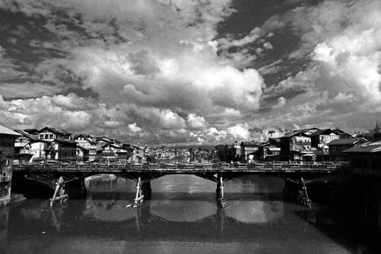 Linked Lineage: Jhelum is witness to all. And that archaic bridge, which has ferrying generations together is equally evident. The 400 hundred years and counting, Isn't there a limit to human endurance. How far could one survive the hostile histrionics?