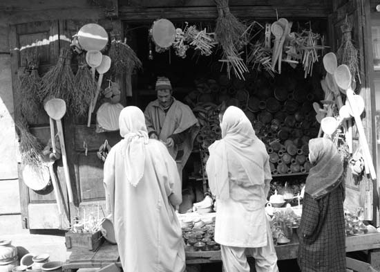 """Cultural Cradle: Those olden days, when earthen piggy-bank would store our precious treasure as a kid, you remember. And that cheerful fellow at street-side, whose wooden-shop would cradle Kashmiri traits, now stands sidelined. He was once heard saying: """"They crumble my piggy-banks under their feet. Since then, kids of my land have ceased to deposit their coin treasures. They are left only to recollect their woes now."""""""