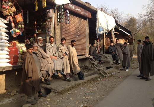People kill time at Zamalgham market during winters.