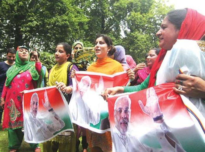 Female Kashmiri BJP activists holding NaMo's banners in Srinagar after BJP emerged as a single largest party in mainland India. Pic: Bilal Bahadur