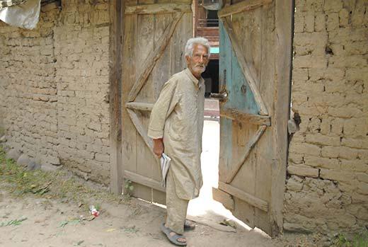Omkar Nath Bhat outside his home in Haal Shopian. Pic: Bilal Bahadur