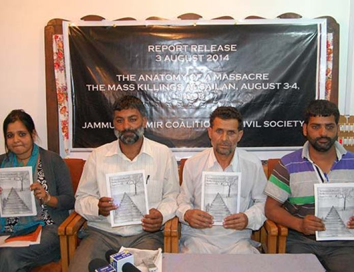 Survivors of Sailan massacre with a Mumbai based researcher during the release of report . Pic: Bilal Bahadur