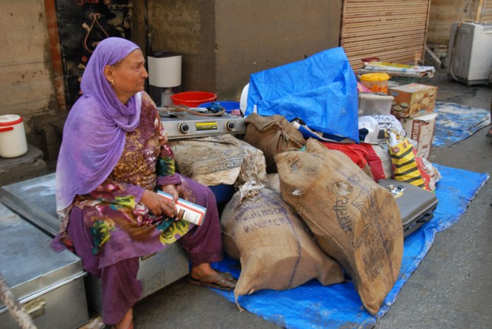 This elderly lady sits outside her flood-torn home in the interior parts of Maisuma.