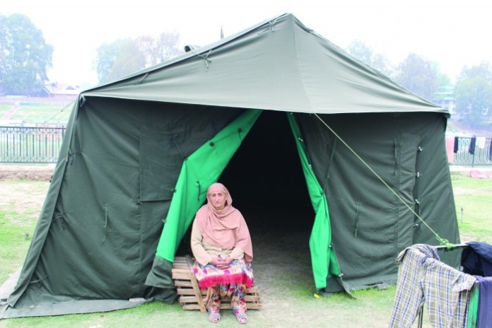 A woman outside a relief camp.