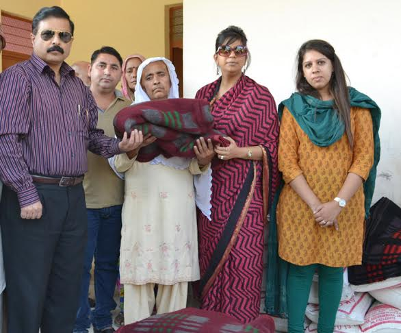 IAS officers Ms Mudgal and Ms Batra issuing relief.