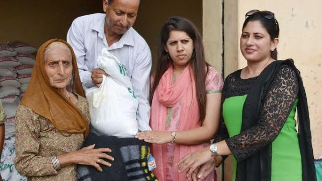 """: Ms Batra and some another subordinate official with an old lady recording """"help""""."""