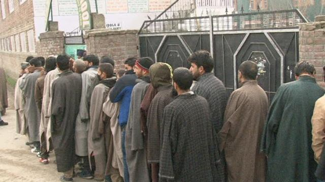 People standing in queue waiting to cast their ballot outside a polling booth in Habba Kadal assembly segment on Sunday.