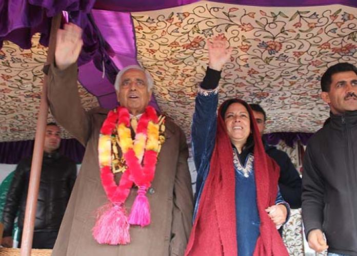 PDP patron Mufti Mohammad Sayeed alongwith Asiya Naqash during Hazratbal rally. Pic: Bilal Bahadur