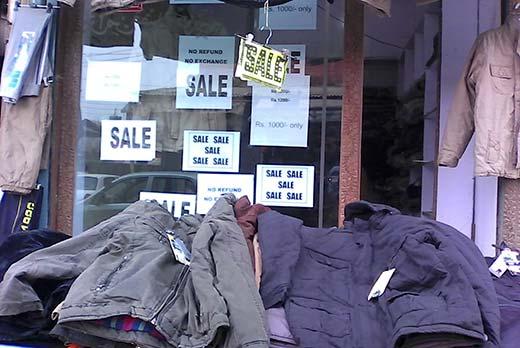 Flood affected  garments on road-side sale in  Srinagar.Pic: Saima Rashid