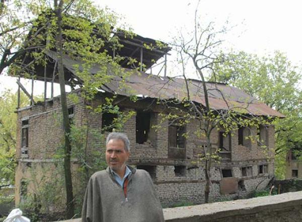 Nazir Ahmad Bhat of Lar Ganderbal keeping vigil on pandit houses.