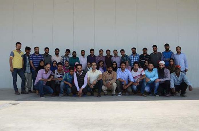 Khuram Shafi with his team outside his IE Lassipora facility. Pic: KL Image: Bilal Bahadur