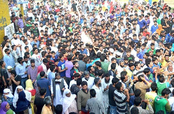 People taking part in funeral of a civlian killed by unknown gunmen in Sopore.