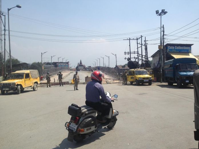 Concertina wires were raised around City Centre as not to allow any protest demonstration by trade fraternity. Police men stand gurad near Amira Kadal from Hari Singh straight. (Pic by: Bilal Bahadur)