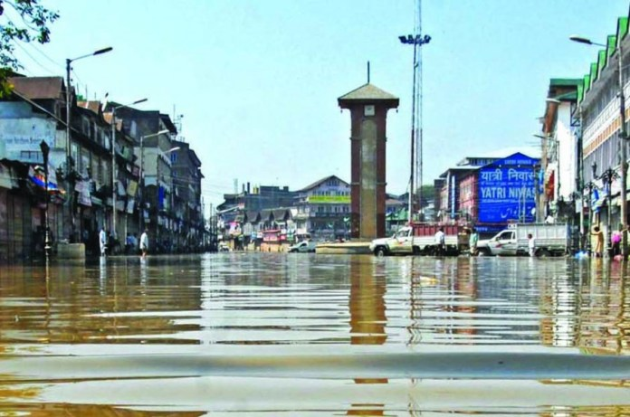 A View of Clock tower at the Flood city centre after devastating flood hit valley on Thursday 18 September 2014 PHOTO BY BILAL BAHADUR