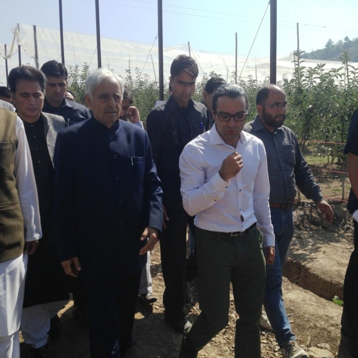 On Stride: Mufti Sayeed, Khurram Mir and others passing through the orchard.
