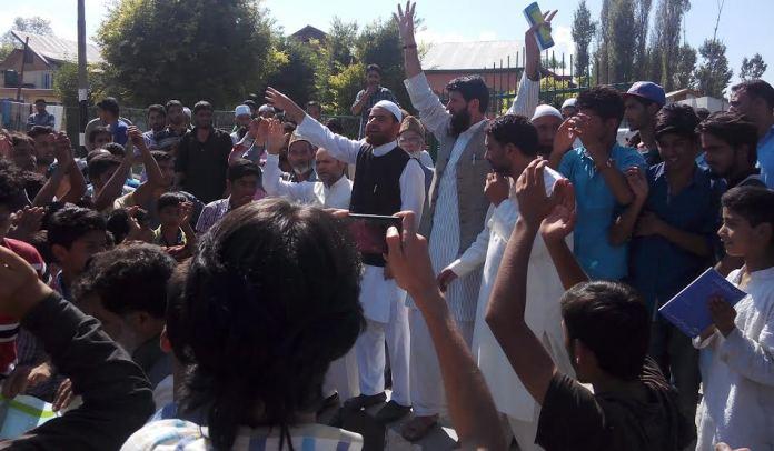Tehreek-e-Hurriyat leaders addressing people at Martyrs Graveyard in Humhama, Budgam on Sunday.