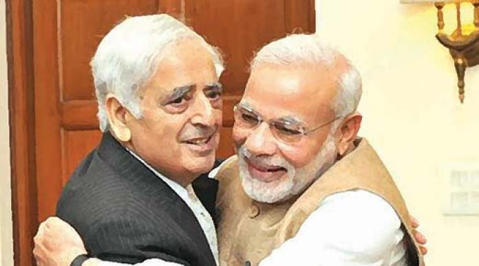 The Hug: CM Mufti with PM Modi in New Delhi when the PDP and BJP joined hands and formed government in J&K.