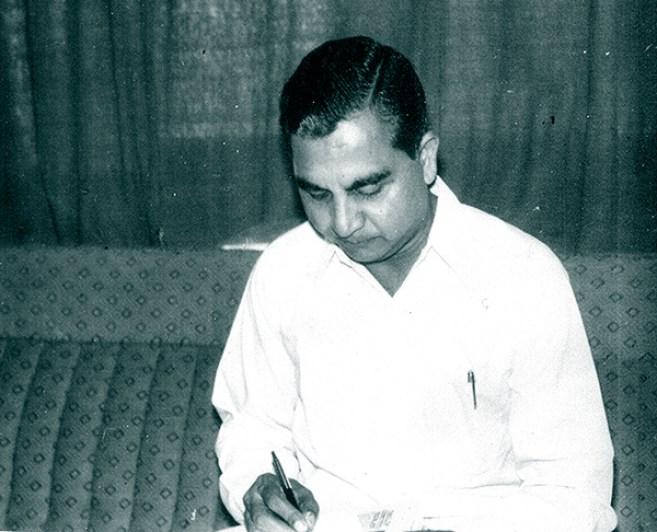 An editor at work: Bhasin writing his notes.