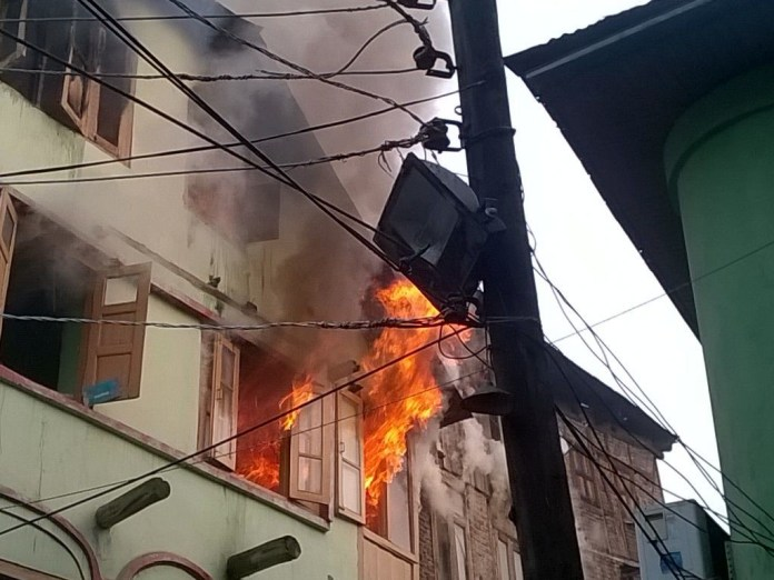 A house on fire at Nawakadal in this file KL Image.