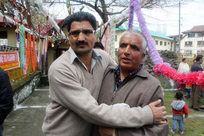 Bita Karate hugging a Kashmiri Pandit.
