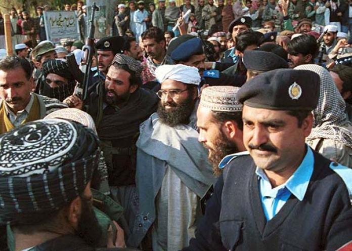 Police taking Masood Azhar in custody.
