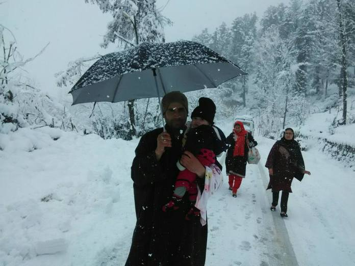 The prolonged dry spell brought complications with it. People made beeline to hospitals to get cured, however, the fresh snowfall halts the miseries from further damages. A parent with his baby in South Kashmir's Kellar area. (KL Image by special arrangement.)