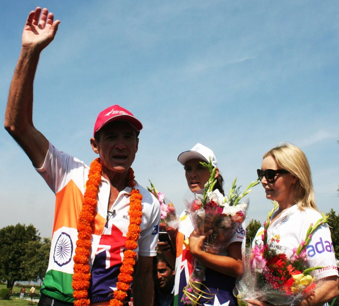 Australian ultra-marathon running legend Pat Farmer flanked with wife, waving to the crowed on arrival at Mughal Garden (Nishat Bagh), on the banks of Dal Lake in Srinagar on Tuesday. Pat reached Srinagr after covering distance of 4600 kms from Kanyakumari under 'Spirit of India Run', flagged off at Kanyakumari in on January 26.  PHOTO BY BILAL BAHADUR