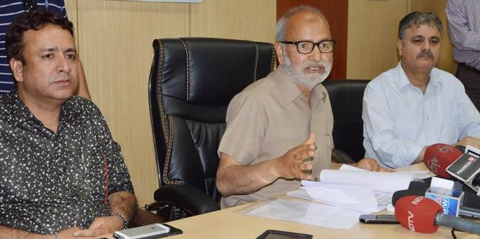 J&K Government spokesperson, Naeem Akhtar, detailing the cabinet decisions in Jammu on April 11, 2016.