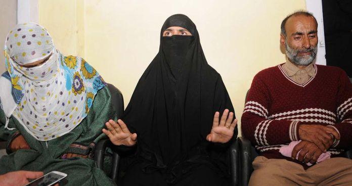 Handwara girl flanked by her parents addressing presser