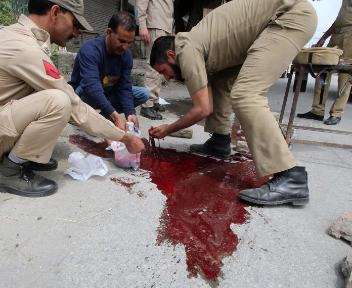 Blood of policemen is collected in a polythene bag by fellow colleagues in Zadibal area of Srinagar on May 23, 2016. Two policemen were shot dead by suspected militants early morning in Srinagar. Police said PHOTO BY BILAL BAHADUR