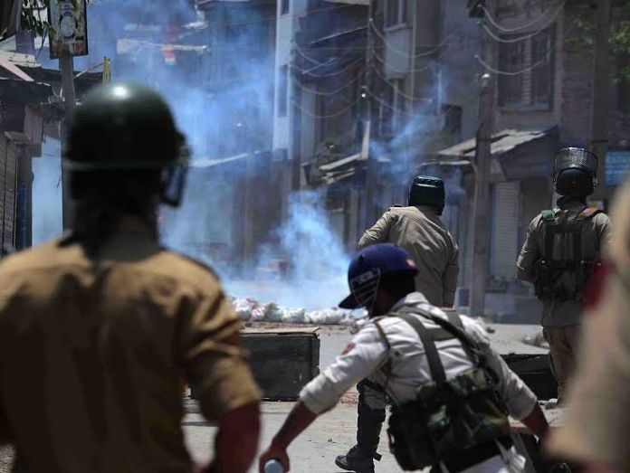 Protesters throw stones at police officers during clashes after the funeral procession of Tanveer Sultan Sheikh, a suspected militant in Srinagar, 15 June 2016. Sheikh and a civilian woman were killed and three Indian paramilitary soldiers were critically injured in a shoot out on 13 June at Kud in Jammu regionPHOTO BY BILAL BAHADUR