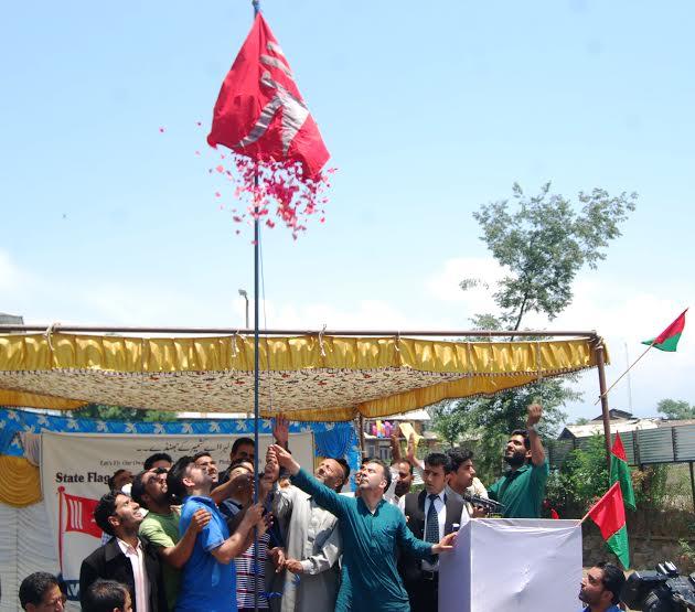 J&K Flag being unfurled in Islamabad by Er Rasheed. (KL Image: Shah Hilal)