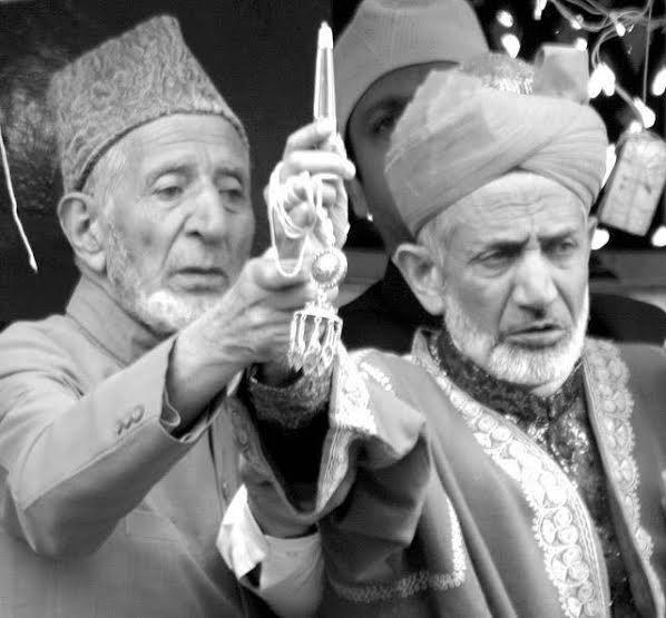 Peerzada Ghulam Jeelani (Left)