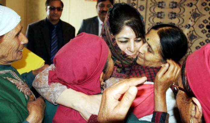 Chief Minister Ms Mufti being greeted by migrant Kashmiri Pandits in Jagti