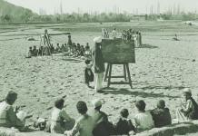 A 1955 photograph showing the students being taught in an open school.