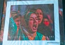 A poster encouraging women to call the helpline number displayed at OSC's office in Srinagar.