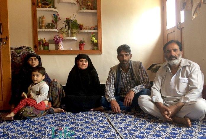 Family members of the slain trio at Asgar's house in Baramulla