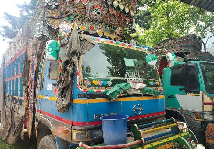 Seized Pakistani trucks in police custody.