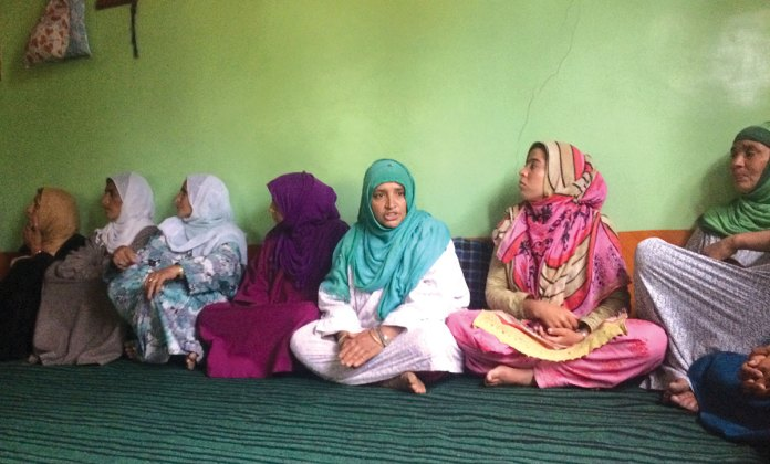 Zaitoona Bhutto (fifth from left) sitting with other members of Zeeshan Group in Nowgam village of Sonawari. KL Image by Shams Irfan