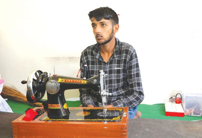 Nisar while learning the tailoring skill.