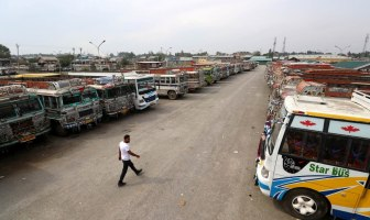 Public transport buses are parked inside Parimpora stand. KL Image: Bilal Bahadur