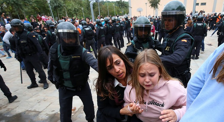 Spain apologises for police action against Catalans demanding independence