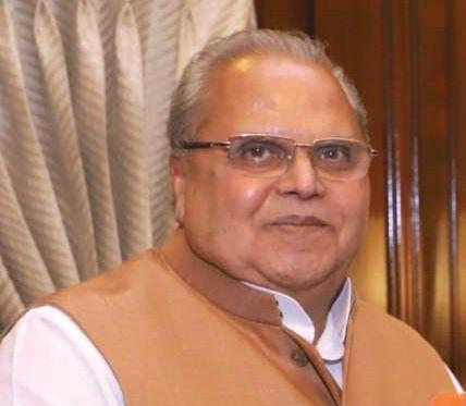 Outgoing Guv Malik meets PM