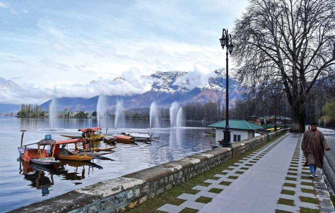 A man walks along Dal lake