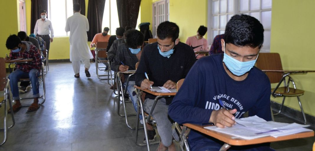 Students wearing masks write class 10 exams in Baramulla