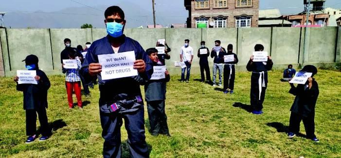 Martial art players demand Indoor stadium in Pampore