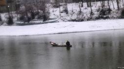 A boatman rows across river Jhelum in Pampore